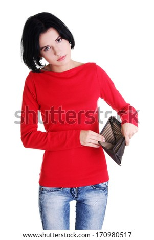 Young woman shows her empty wallet. Bankruptcy concept - stock photo