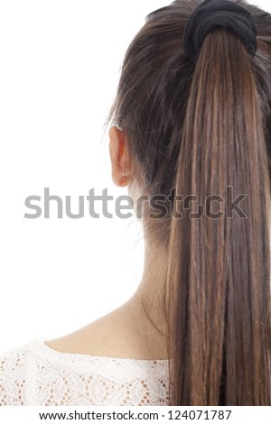 Young woman shows her long hair back - stock photo