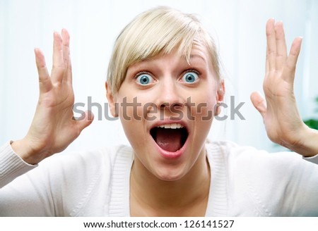young woman shows off her emotional fear and  scream - stock photo