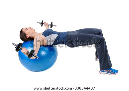 Young woman shows starting position of Fitball Dumbbell Chest Fly's Workout, isolated on white - stock photo