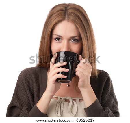 Young woman sipping from a cup,isolated on white - stock photo
