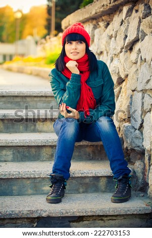 Young woman siting on stair - stock photo