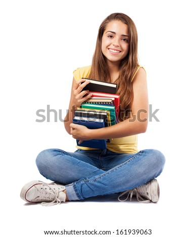 young woman sitting and hugging a books pile - stock photo