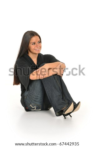 Young woman sitting and smiling - stock photo