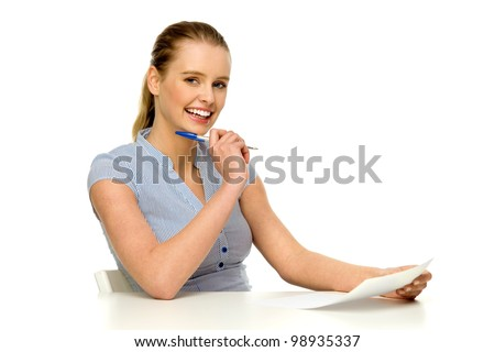 Young woman sitting at white table - stock photo