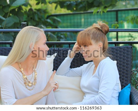 Young woman sitting in street cafe. - stock photo