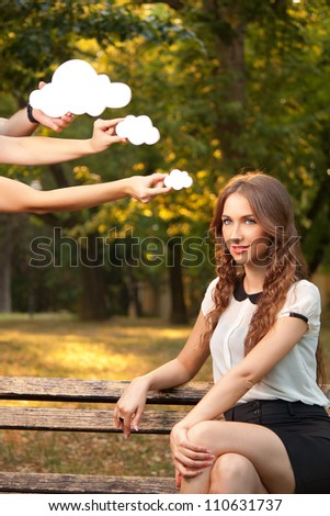 Young woman sitting on a bench and thinks - stock photo