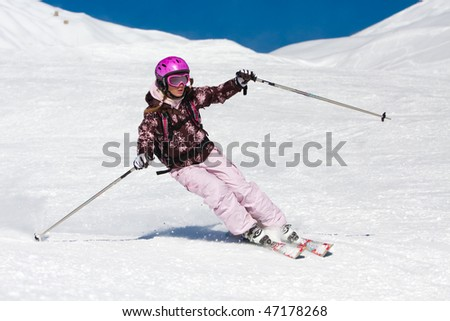 Young woman skiing fast on the slope. Winter vacation - stock photo