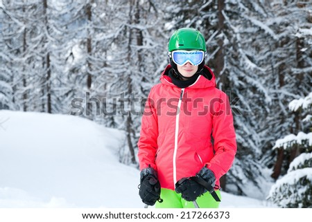 Young woman skiing in the Alps - stock photo