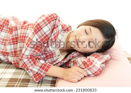 Young woman sleeping - stock photo