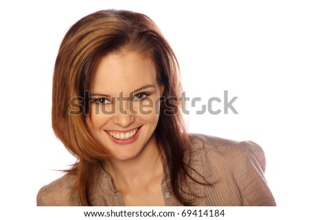 Young woman smiling at the camera - stock photo