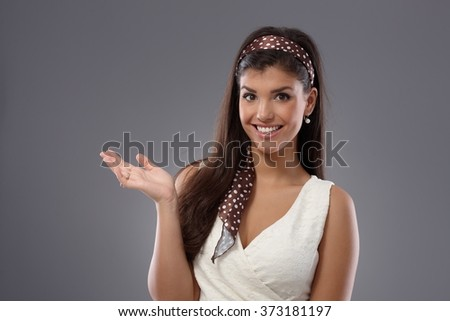 Young woman smiling happy, gesturing with hand. - stock photo