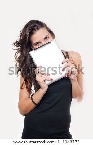 Young woman smiling holding a tablet - stock photo