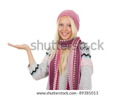 young woman smiling holding hand showing something on the open palm with empty copy space, wear winter knitted hat scarf and sweater, concept of advertisement product, isolated over white background - stock photo