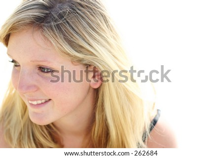 young woman smiling while looking sideways - stock photo