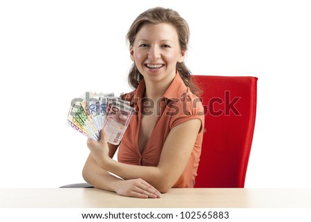 Young woman smiling with euronotes fan in her hand - stock photo