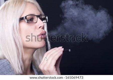 Young Woman Smokin Electic Cigarette - stock photo