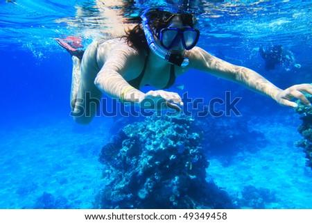 Young woman snorkeling near Tiran Island in Red Sea - stock photo