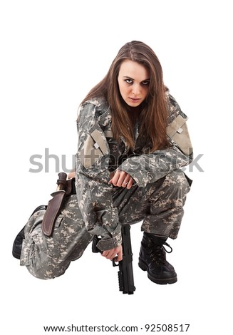Young woman soldiers with gun, isolated on white background - stock photo
