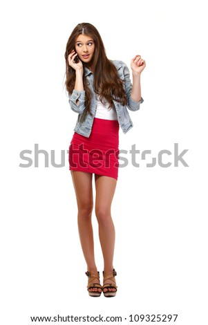 young woman speaking on telephone - stock photo