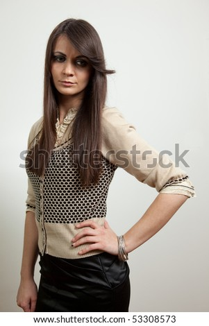 Young woman standing - stock photo
