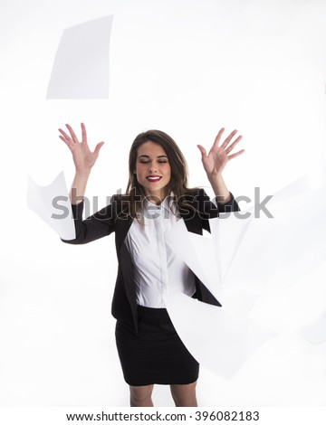 Young woman standing and throwing away papers - stock photo