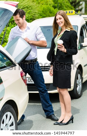 Young woman standing in front of taxi, she has reached her destination, the taxi driver will help with the luggage - stock photo