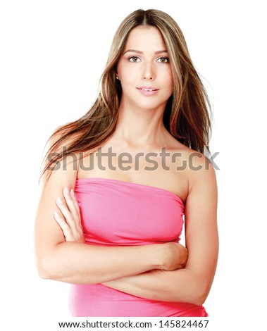 Young woman standing with folded arms isolated on white background - stock photo
