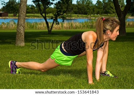 Young woman stretching her hamstring muscle. - stock photo