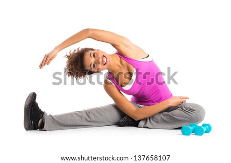 Young Woman Stretching Isolated On White Background - stock photo