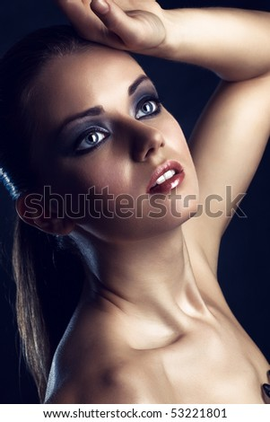 Young woman studio fashion portrait. Dark blue background. - stock photo