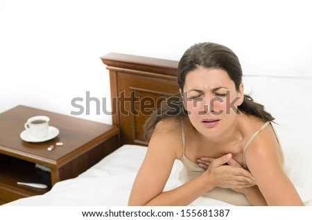 Young woman suffering a heartache - stock photo