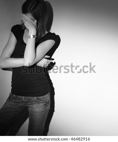 Young woman suffering from a severe depression - stock photo