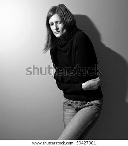 Young woman suffering from a severe stomach pain/depression/anxiety - stock photo