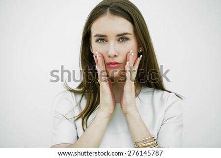 Young woman suffering of the pain over white background