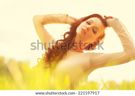 Young woman sunny portrait. - stock photo