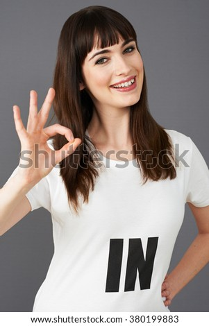 Young Woman Supporter Wearing T Shirt Printed With IN Slogan - stock photo