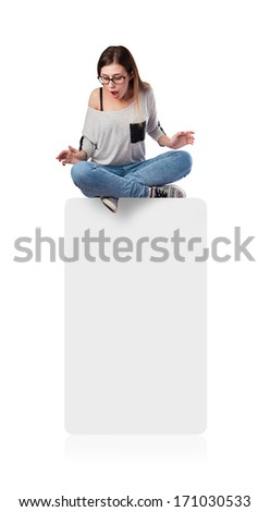 young woman surprised looking down a blank space - stock photo