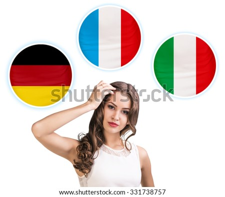 Young woman surrounded by dialogue bubbles with countries flags. Germany,  Italian, Czech. Learning of foreign languages concept.  - stock photo