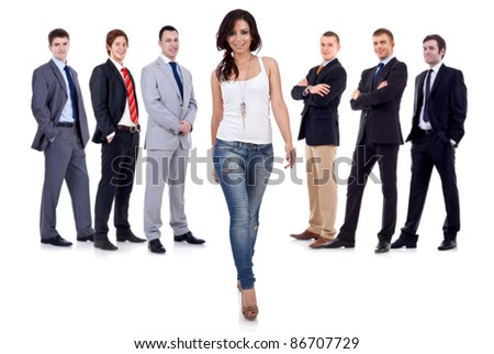 young woman taking a break from her business team and walking towards the camera - stock photo