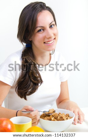 Young woman taking a breakfast cereal at home - stock photo