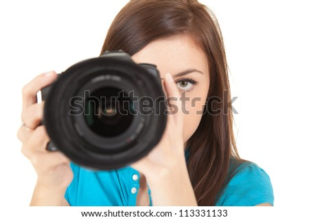 young woman taking a photo with a digital camera, white background - stock photo