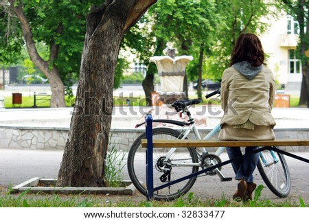 Young woman taking a rest from biking - stock photo