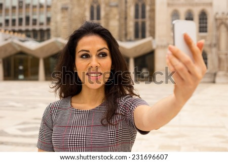 young woman taking a selfie - stock photo