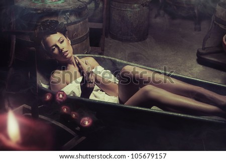 Young woman taking bath - stock photo