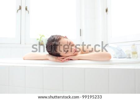 young woman taking bath - stock photo