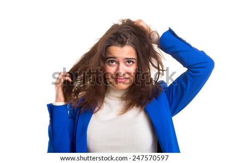 Young woman taking care of her hair isolated over white - stock photo