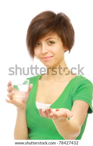 young woman taking pill close up - stock photo