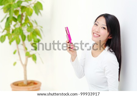 Young woman talking by mobile phone. Portrait of asian woman. - stock photo
