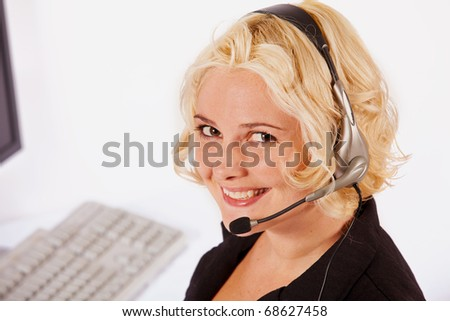 Young woman talking on a headset - stock photo